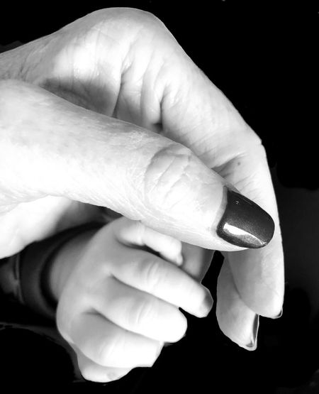 Generations ... love Generations Love Human Hand Human Body Part Human Finger Holding One Person Close-up Black Background