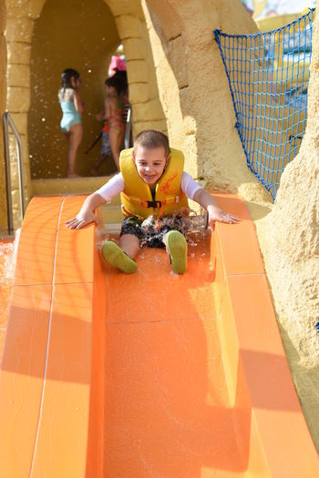 Full length of excited boy on slide at hersheypark