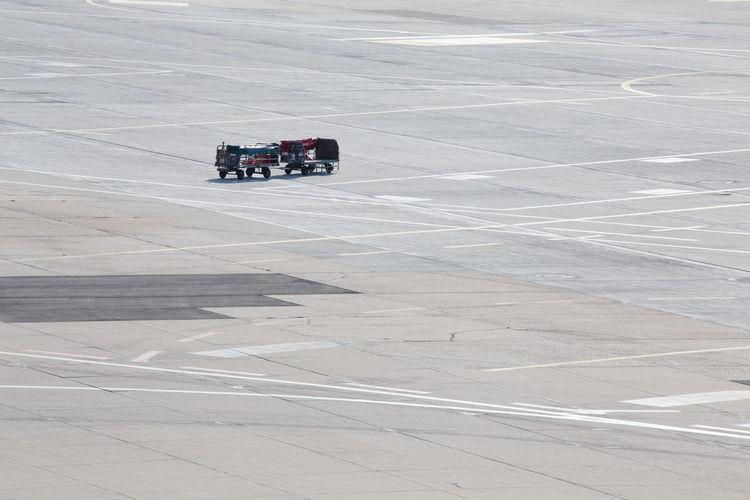 Trolleys on airport runway
