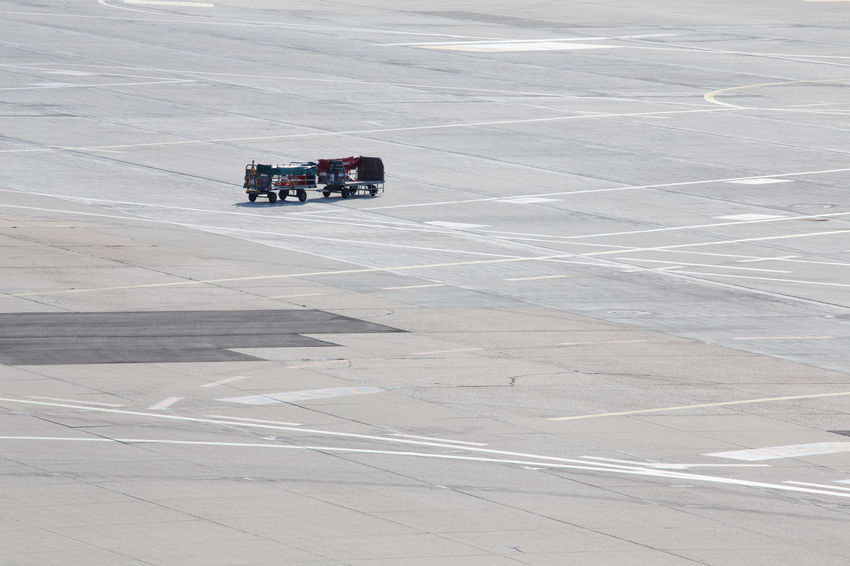 Lost Missing Runway Travel Traveling Airport Airport Waiting Baggage Baggage Cart Day Empty High Angle View Luggage Mode Of Transport No People Outdoors Problems Road Space Taxiway Transportation