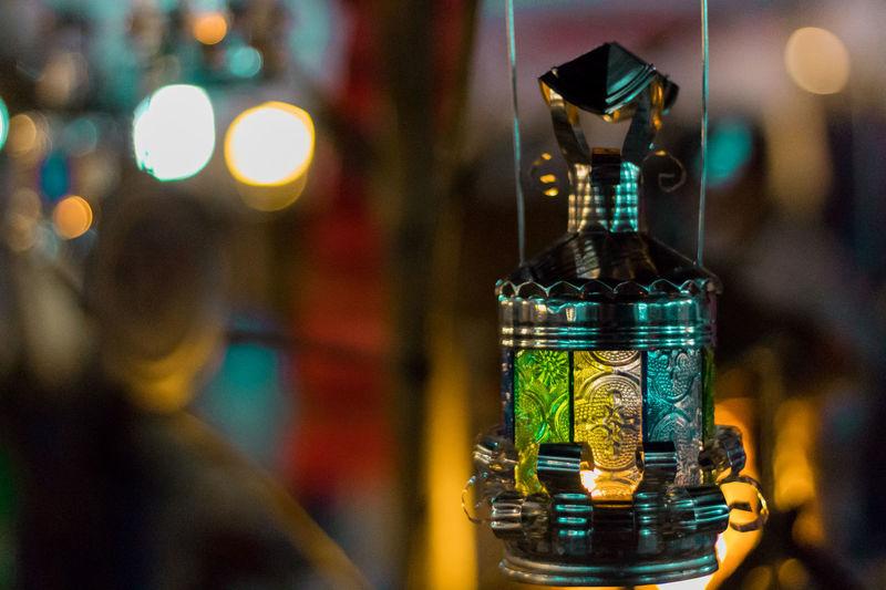 Close-up of illuminated wine bottles on table