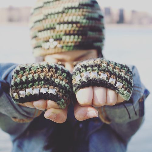 Close-up of person with knitted gloves