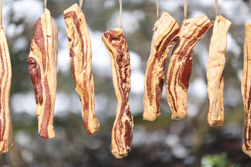 Close Up Of Bacon Against Trees