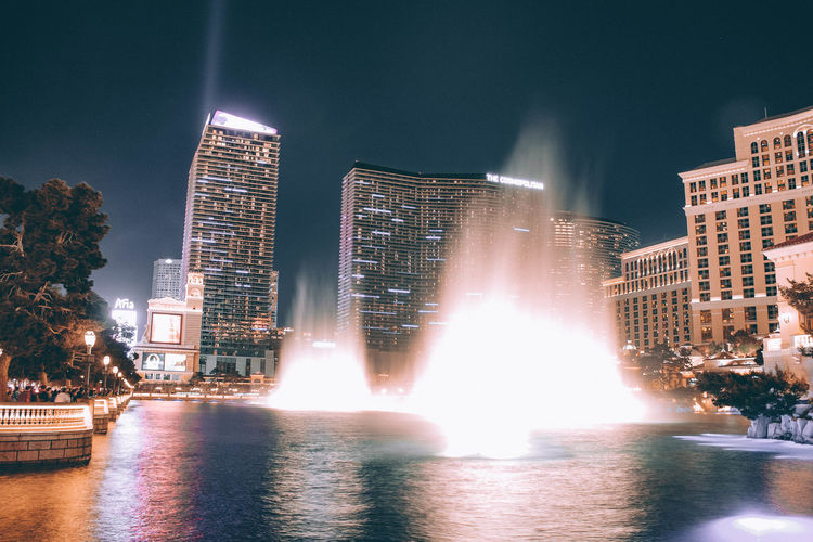 Architecture Blurred Motion Building Building Exterior Built Structure City Cityscape Flowing Water Fountain Illuminated Lens Flare Long Exposure Modern Motion Nature Night No People Office Building Exterior Outdoors Sky Skyscraper Spraying Tall - High Water Waterfront