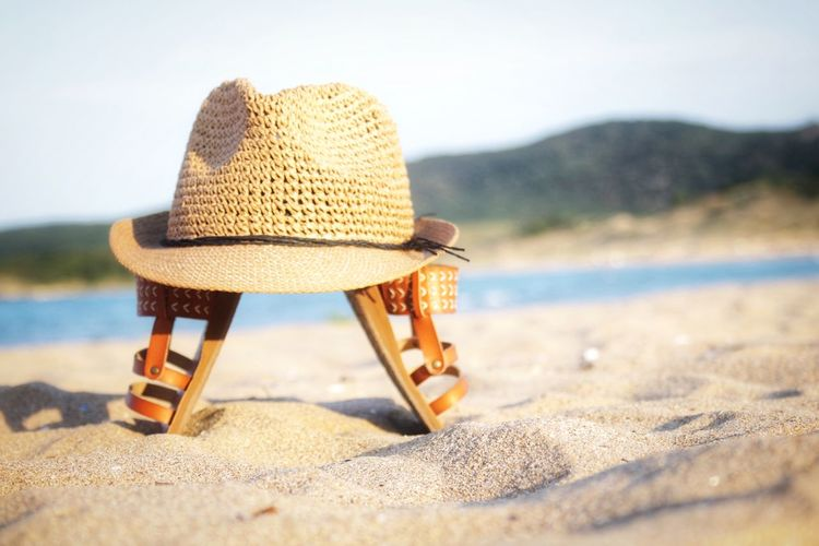 At the beach Godiscoversummer Summer Still Life Hat Land Beach Nature Day Sand Seat Water Sky Sun Hat Sunlight Tranquility Focus On Foreground Scenics - Nature Selective Focus Clothing Absence Beauty In Nature Outdoors No People Summer Exploratorium