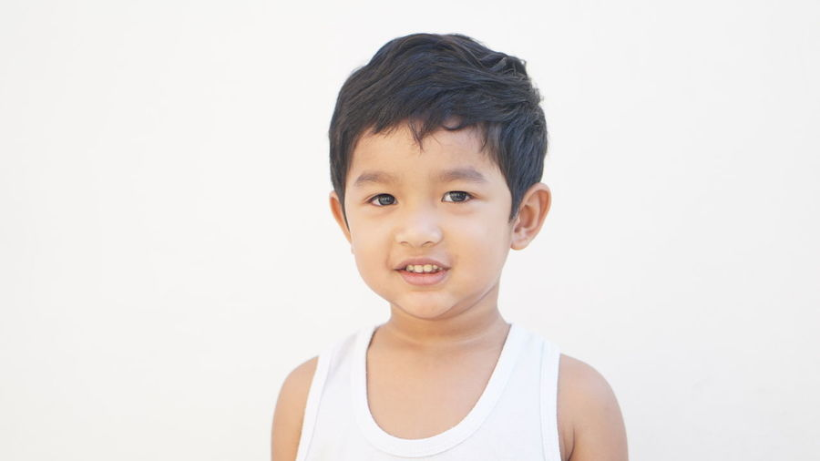 Portrait of boy against white background