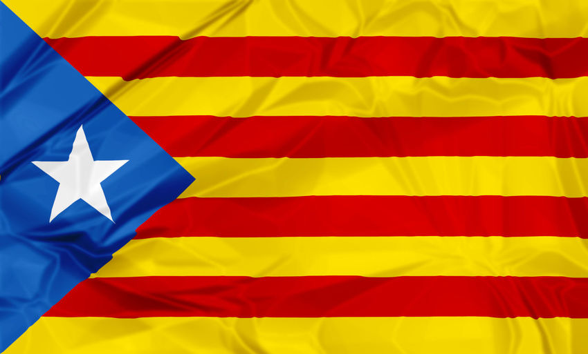Waving Estelada Blava flag of Catalonia in Spain, or Eastern Catalan, red and yellow stripes with five pointed star in a triangle. Senyera estelada or starred flag or lion star flag. 3d background. Catalonia Photography Catalonia Is Not Spain Catalonia Square International Patriot Patriotism Backgrounds Blue Catalonia Culture Catalonia Flag Close-up Flag Flags In The Wind  Full Frame Indoors  Multi Colored No People Patriotism Pattern Pride Red Shape Star Shape Striped Textile Textured  White Color Yellow