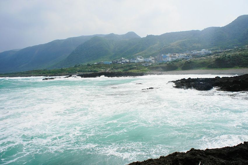 View of village on Lanyu, the Orchid Island, Taiwan Village View EyeEm Taiwan Lanyu Gettylicious Taiwan Orchid Island Stockphoto Travel Newstrekker Travel Destinations Storm Orchid Island Village Houses Waves Stormy Stormy Weather Taiwanese Nature Photography Offthebeatenpath Nature