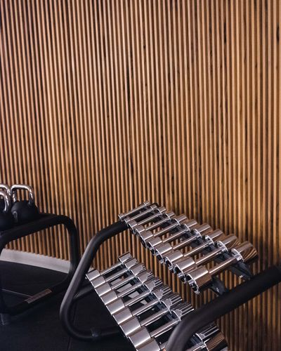Arts Culture And Entertainment Indoors  No People In A Row Retro Styled Wood - Material Absence Close-up Pattern Empty Antique Stage Gym Training Dumbbell Gym Equipment Sport Silver Colored