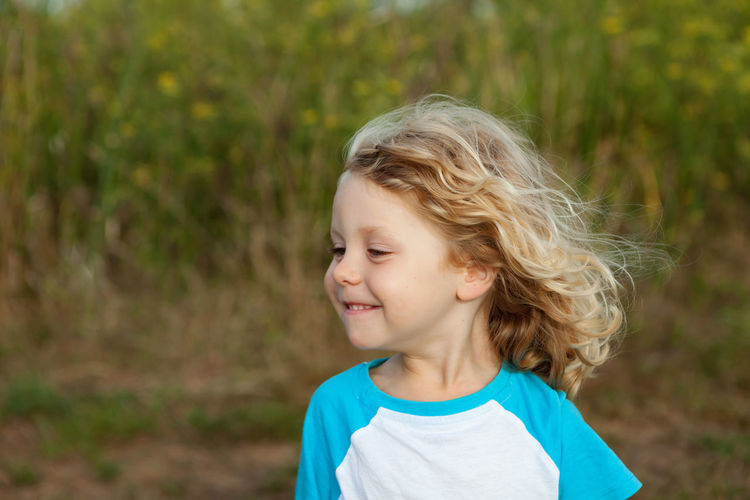 Portrait of cute smiling woman outdoors