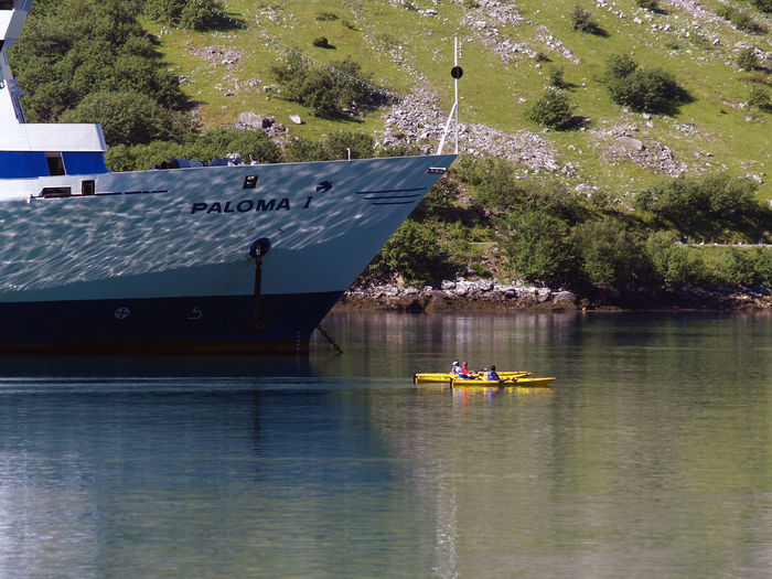 Beauty In Nature Big Ship Day Kayaking Mode Of Transport Nature Nautical Vessel On Fjords Outdoor Activity Outdoors Smal Boat Small And Big Transportation Water Waterfront