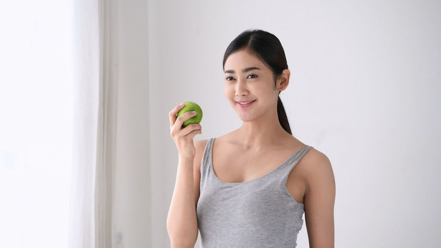 Antioxidant Appetizing  Asia Girl Asian Face Beautiful Women Beauty Concept Bed Body Slender Chew Choice Control Fat Delicious Detox Diet Program Dieting Eco System Female Fill Happiness Fitness Fresh Fruit Green Apple Happy Healthy Health Care Holiday Vacation House Wife Japanese  Lady Woman Lifestyle Leisure Living Room Lose Weight Low Calorie Meal Obesity Rate One People Proper Nutrition Recommendation Reduce Eat Refreshing Lips Repair System Select Slimming Sweet Smile Vegetable Vegetarian Food Vitamins Minerals Weight Wellness Programs White Background Young Adult Youth