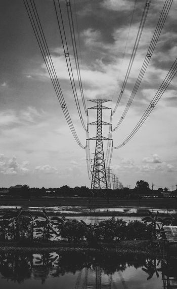 Electricity  Sky Cloud - Sky Cable Electricity Pylon Power Line  Power Supply Technology Fuel And Power Generation Connection Nature Water No People Day Reflection Outdoors Low Angle View Built Structure Beauty In Nature