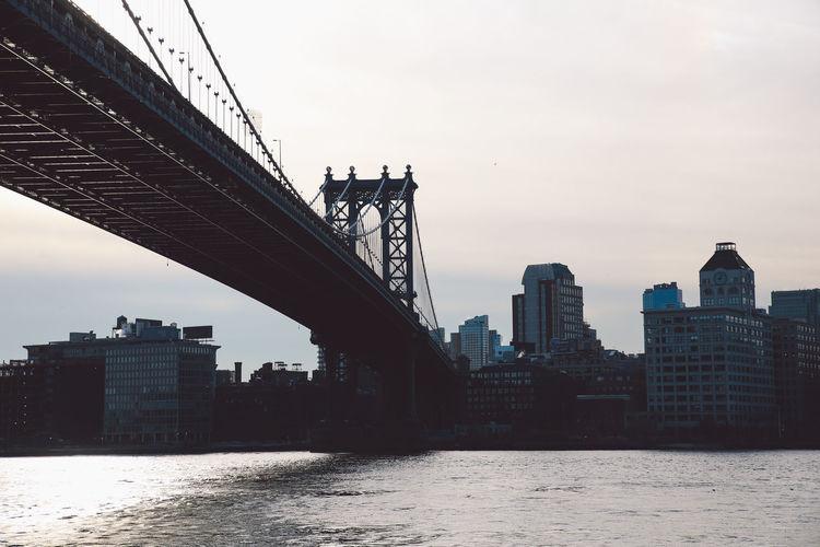 Manhattan Bridge Over East River Against Sky
