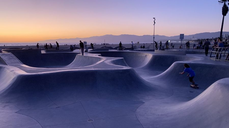 People at skateboard park during sunset