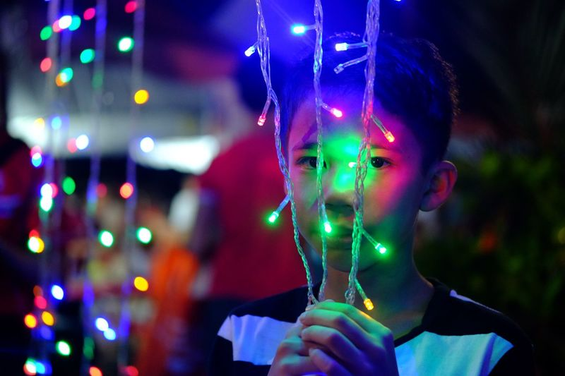 One Person Headshot Portrait Holding Focus On Foreground Front View Illuminated Connection Technology Green Color Adult Glowing Multi Colored Night Young Adult Celebration Teenager Indoors  Standing Humanity Meets Technology