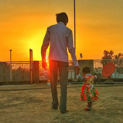 EyeEm Selects Love Sunset Kid Kids Hands Sunset People Rear View One Person Standing Only Men Outdoors Sky Adult Day