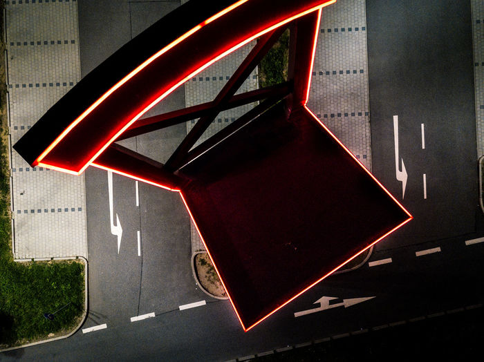 High angle view of illuminated neon sign