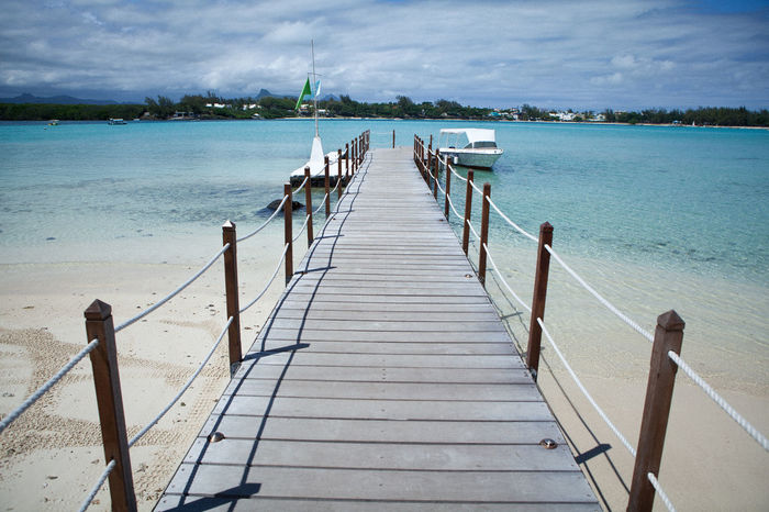 Beach Boardwalk Boats Bridge - Man Made Structure Cloud - Sky Coconut Island Landscape Leisure Activity Mauritius No People Pier Railing Relaxation Relaxing Sea Seascape Sky Tropical Paradise Water Still Life Point Of View Miles Away