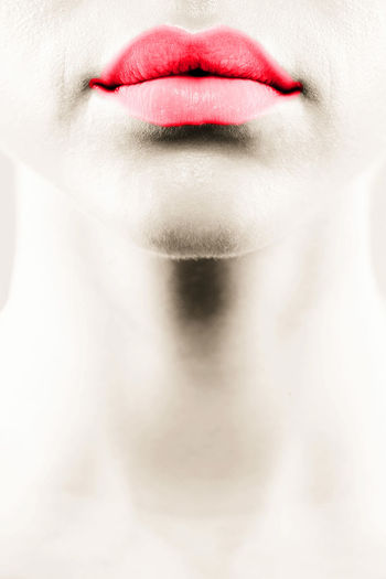Cropped image of woman with red lipstick