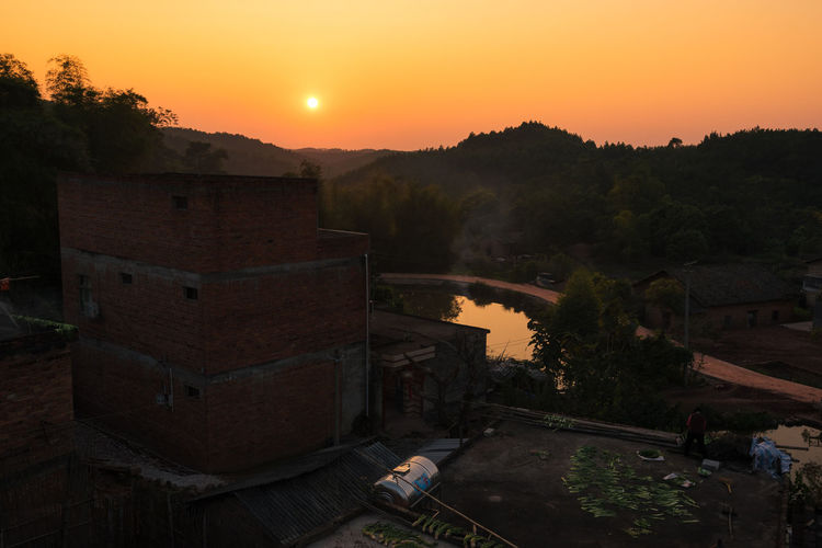 Scenic view of village at sunset