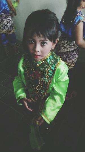 A child with the custom dance. Traditional Clothing Looking At Camera Girls Portrait Children Only Performing Arts Event Sendratarisrirama Beautifull Looking At Camera Close-up Green