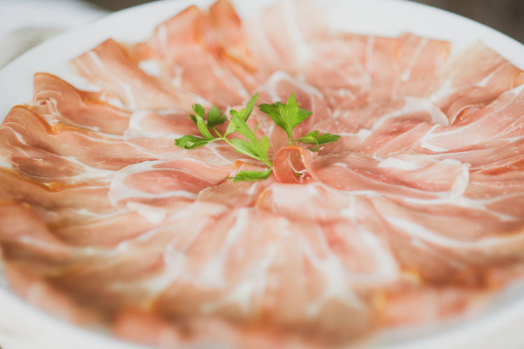 High Angle View Of Cold Cuts Served With Herbs In Plate