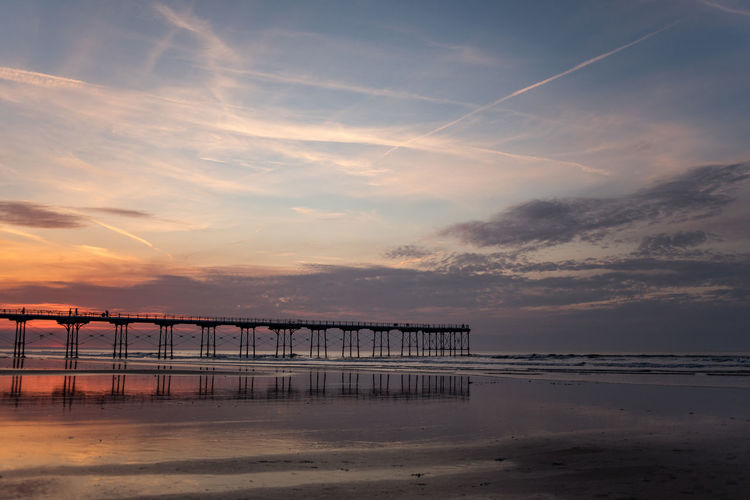 Saltburn beach at sunset. Saltburn is a seaside town on the north east coast of England. The pier recently celebrated it's 150th year. Teesside Yorkshire North Yorkshire Saltburn Pier Piers Saltburn Pier Sunset Beauty In Nature Coast Coastline Coastal Feature North East Coast North East England North East UK Sunsets Sunset_collection Sunset Silhouettes Sunset #sun #clouds #skylovers #sky #nature #beautifulinnature #naturalbeauty #photography #landscape Sunrise Sunrise_sunsets_aroundworld Sunrise_Collection Sunrise Silhouette Silhouette Silhouettes Silhouette_collection Silhoutte Photography Silhouette Photography Sun Sunset Beach