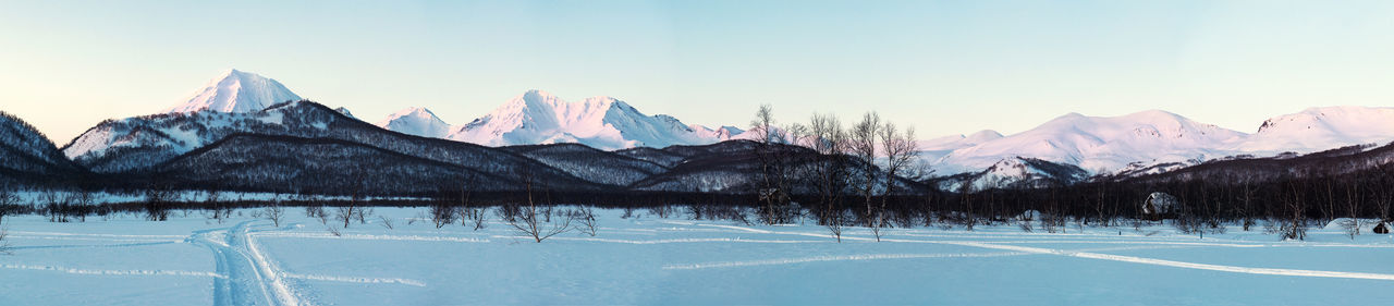 Sunrise over Nalychevo Nature Park and Koryaksky volcano. Kamchatka peninsula, Russia Far East Frost Kamchatka Krai Nalychevo Nature Park Nature Panorama Panoramic Petropavlovsk-Kamchatskiy Russia Winter Wintertime Beauty In Nature Cold Temperature Frozen Nature Kamchatka Kamchatka Peninsula Landscape Mountain Range Mountains No People Nobody Outdoors Snow Snowcapped Mountain Sunrise