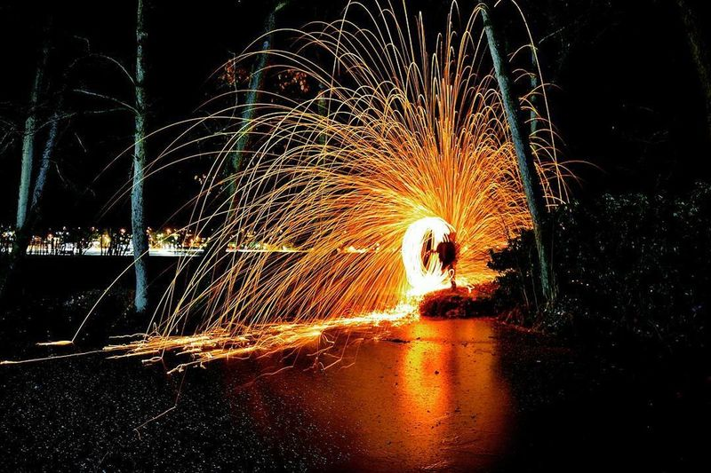 Night Motion Long Exposure Glowing Illuminated One Person Wire Wool Heat - Temperature Burning Silhouette Ember Flames Color Swatch Multi Colored Nightphotography Nature Element Elements First Eyeem Photo Circle 33 9 Mm 13 Water