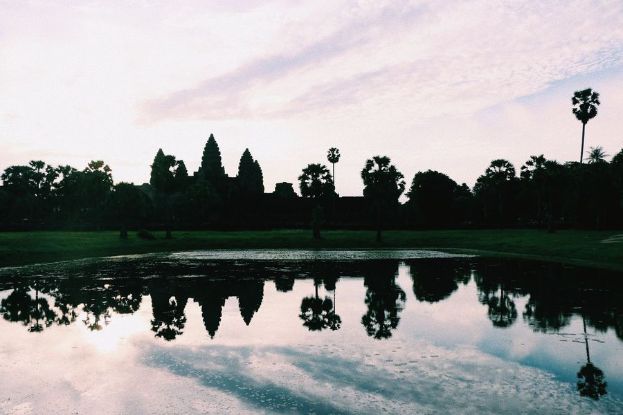 Angkor Wat Architecture Beauty In Nature Built Structure Cambodia Day Grass Growth Lake Nature No People Outdoors Puddle Reflection Scenics Silhouette Sky Sunset Tranquil Scene Tranquility Travel Destinations Tree Water Waterfront