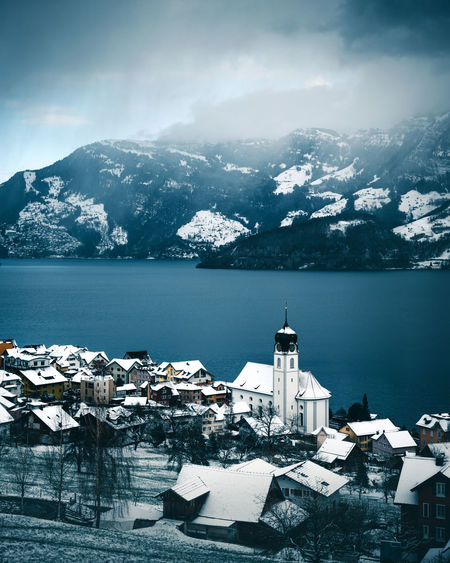 Blue Tones Church The Week On EyeEm Architecture Beauty In Nature Beckenried Building Exterior Built Structure Cold Temperature Day Lake Lucerne Mountain Mountain Range Nature No People Outdoors Scenics Sea Snow Spirituality Switzerland Vierwaldstättersee Village Water Winter