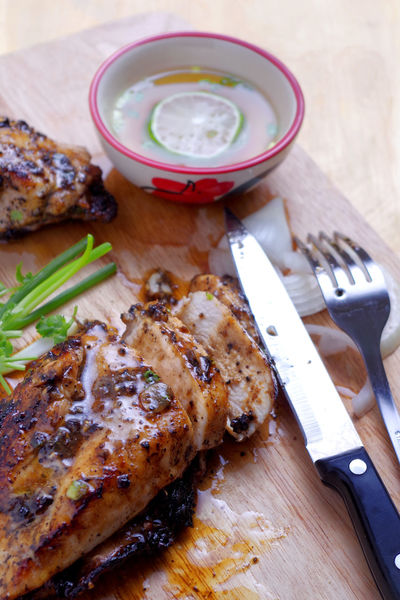 Chicken - Bird Chicken Steak Close-up Cooked Cutting Board Day Food Food And Drink Fork Freshness Grilled Indoors  Knife Meat No People Ready-to-eat Savory Food Serving Size Steak Wooden Material
