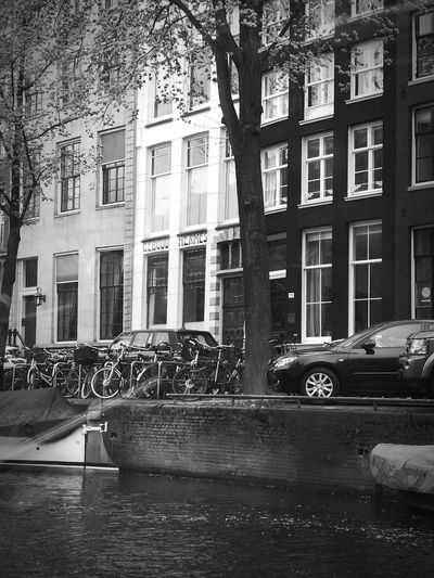 Amsterdam Canal Blackandwhite Street Photography Streetphoto_bw Travel Photography Architecture Car Building Exterior Built Structure Outdoors City Transportation Day Land Vehicle Tree No People Politics And Government The Street Photographer - 2017 EyeEm Awards The Architect - 2017 EyeEm Awards