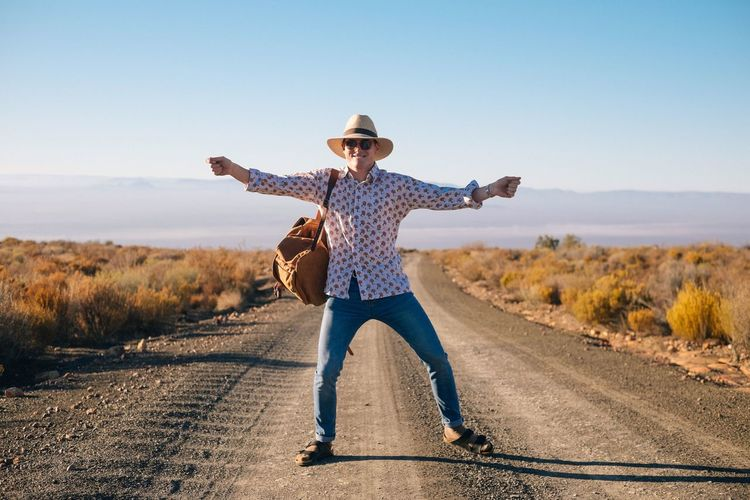 The Tankwa Karoo with Abe Louw One Person Full Length Casual Clothing Road Real People Leisure Activity Outdoors Standing Rear View Walking Day Clear Sky Lifestyles Transportation Sunlight Motion Adventure Landscape Nature Young Adult