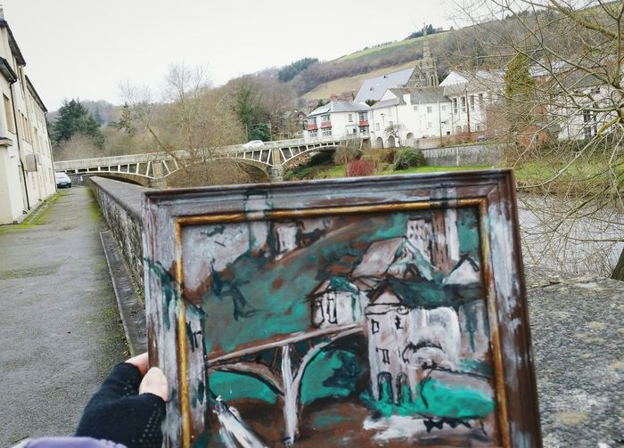 ... the very Beginning of Something Different ... Painting Newtown Powys Sketching Sketch Built Structure Architecture Building Exterior Human Body Part People Outdoors Bridge One Person Day Adults Only Adult Wales Hand Brown Green Acrylic Painting Beginnings River Augmented Reality