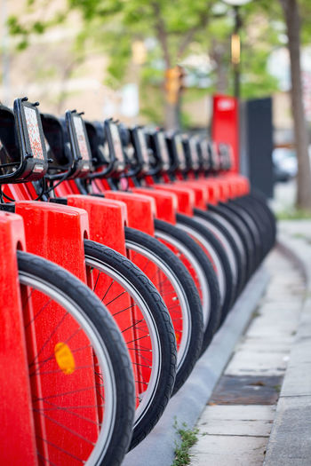 Close-up of bicycles parked at station