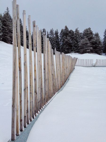 Wooden fence in winter. Connection Fence In A Row Outdoors Protection The Way Forward Wood Wood - Material Wooden