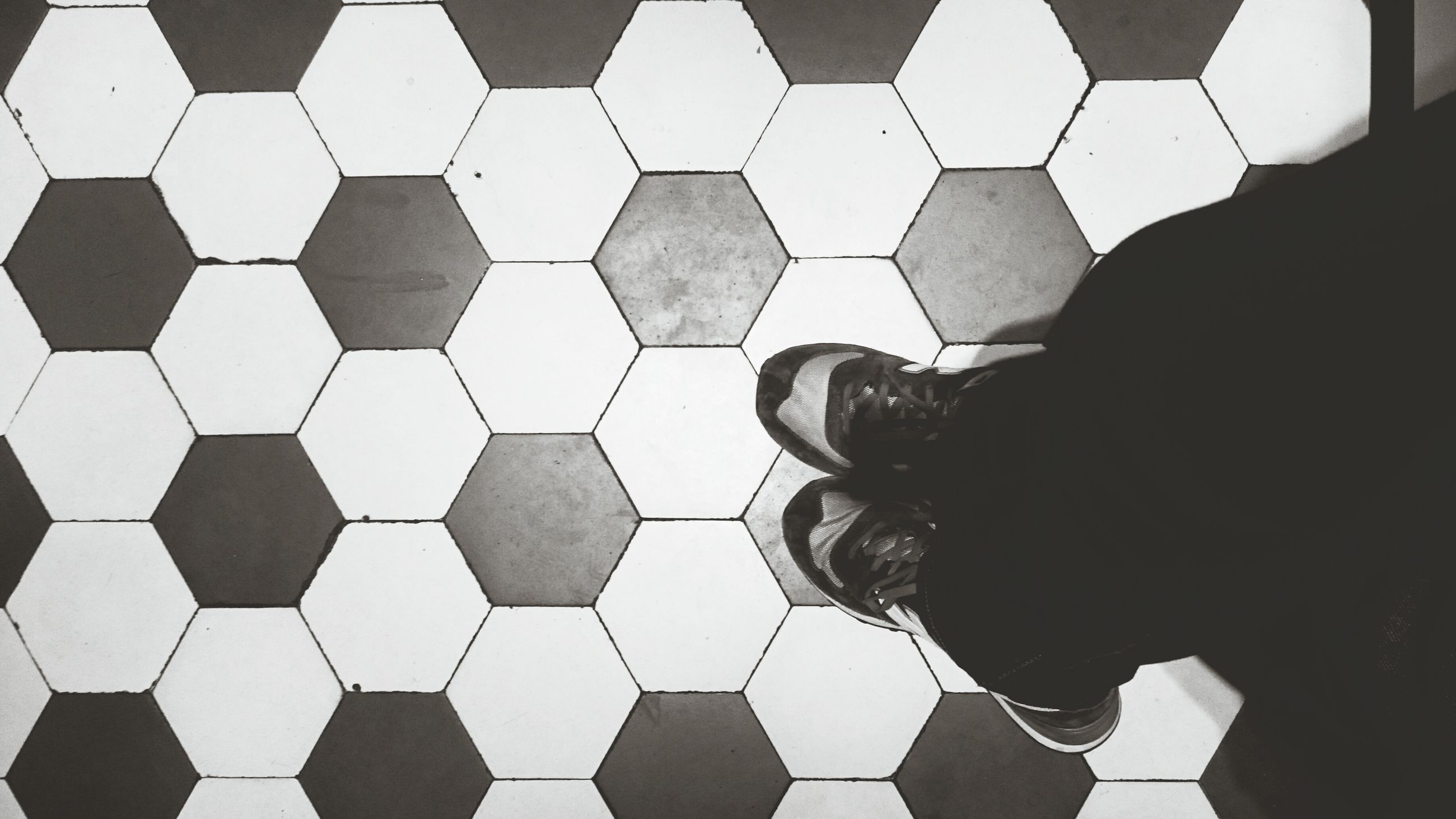 low section, person, shoe, high angle view, footwear, men, personal perspective, outdoors, day, footpath, contrasts