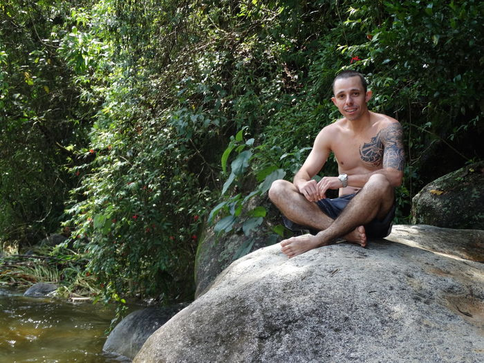 Brazil Itatiaianationalpark Meditation EyeEm EyeEmNewHere Sitting One Person Full Length Happiness Front View Portrait Smiling Day Looking At Camera