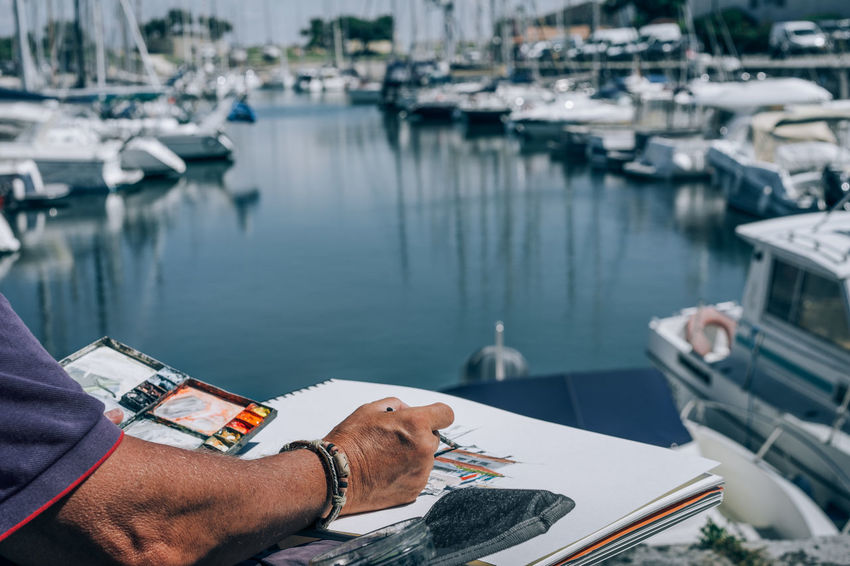 Painter - Artist Painting In Progress Painting Tools Painting Painter Harbor Harbour Summer Sunny Day Sea Nautical Water Relaxation High Angle View One Person Adult Day One Man Only Adults Only Nautical Vessel Only Men People City Close-up Outdoors Business Stories Summer Exploratorium Small Business Heroes