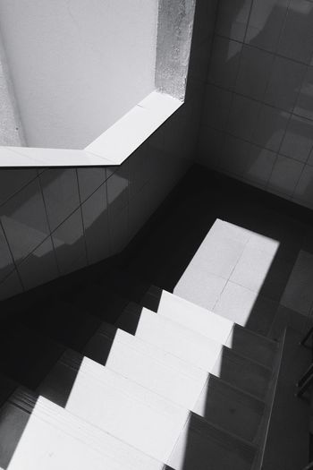 Architecture No People Indoors  Staircase Pattern Sunlight Shadow Abstract Built Structure Day Close-up Steps And Staircases Nature High Angle View Spiral Wall - Building Feature Business Finance And Industry Archival Concrete Blackandwhite