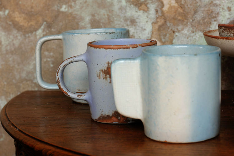 Coffee cup made of ceramic is placed on a wooden table. Ceramics Close-up Coffee Cup Container Cup Drink Focus On Foreground Food And Drink Household Equipment Indoors  Jug Mug No People Old Pitcher - Jug Refreshment Still Life Table Tea Cup Tray Wood - Material
