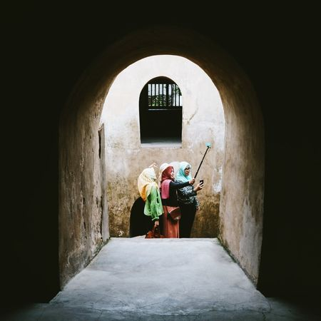 Ancient Architecture Architecture ASIA Asian  Colorful Corridor Day Girls Headscarf Hijab Historical Building INDONESIA Indoors  Light And Shadow People Selfie Selfie Stick Sighsteeing Taking Selfies Taman Sari Travel Destinations Traveling Water Castle Water Castle Taman Sari Yogyakarta