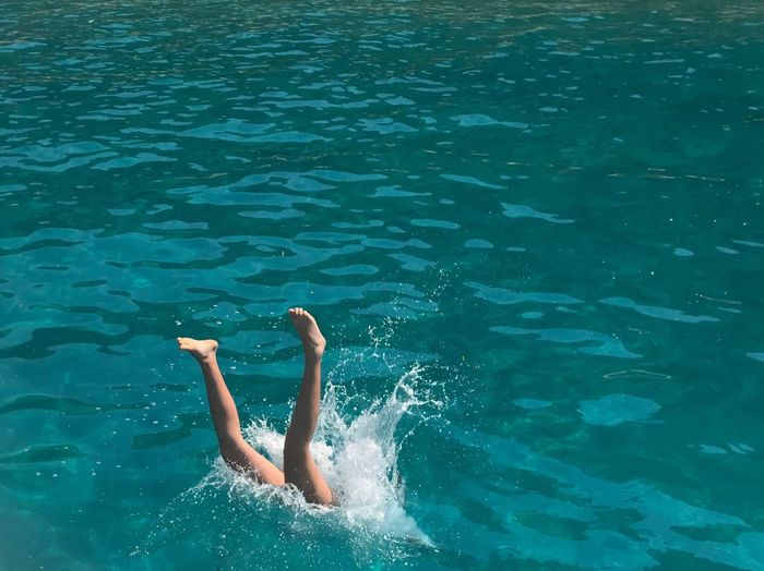 Low section of woman diving in sea