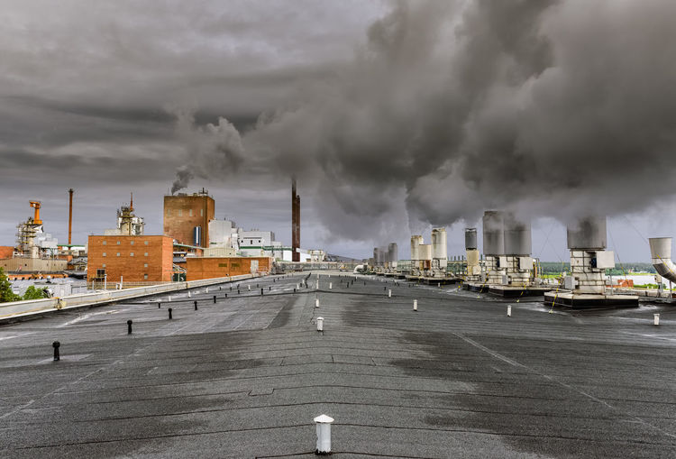 on the roof of a paper mill Chimney Industrial Architecture Industry Roof Steam Architecture Building Exterior Built Structure Factory No People Outdoors Paper Mill Sky Smoke Stack Swedish Paper Mill Urban Skyline