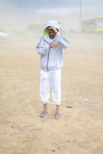 Sandstorm EyeEm Best Shots EyeEm Selects EyeEm Gallery Beach Casual Clothing Clothing Day Front View Full Length Land Leisure Activity Lifestyles Looking At Camera Mature Men Nature One Person Outdoors Portrait Real People Sand Sandstorm Smiling Standing Uniform