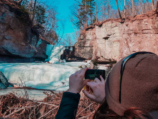 Rock Explore Exploring Winter Trip Ice River Cold Temperature Waterfall One Person Day Real People Lifestyles Leisure Activity Adult Low Section Outdoors Men People Only Men Water Human Body Part Nature EyeEmNewHere Modern Workplace Culture Go Higher Going Remote Focus On The Story