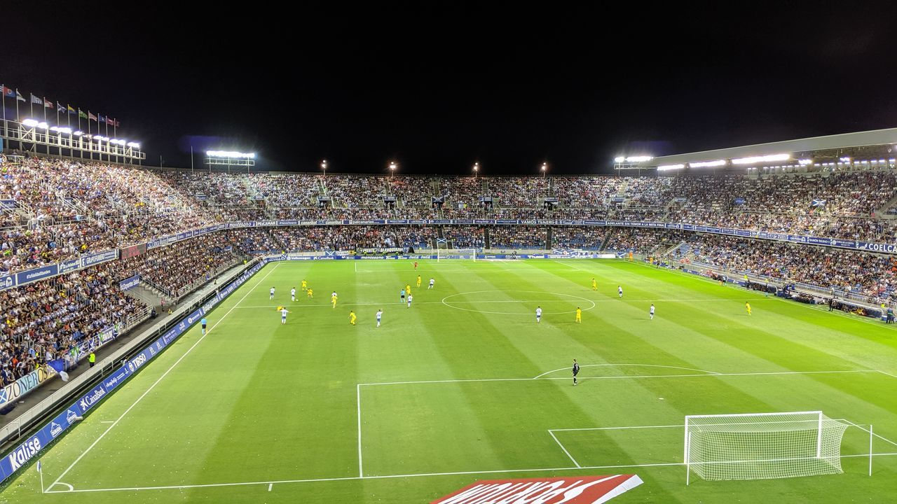 HIGH ANGLE VIEW OF SOCCER FIELD AGAINST SKY