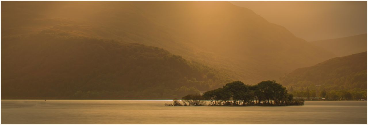 Loch Lomond golden sunset Beautiful Golden Sunset Golden Sunset Loch Lomond Golden Sunset On Golden Loch Beauty In Nature Day Lake Landscape Loch Lomond Mountain Nature No People Outdoors Scenics Sky Sunset Tranquil Scene Tranquility Tree Water Waterfront